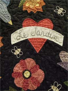 Close-up, hand quilting and embroidery on Le Jardin by Denise St. Sauveur, design by Bonnie Sullivan.  Photo by Quilt Inspiration