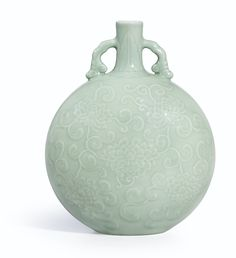 A magnificent and very rare carved celadon-glazed moonflask, Seal mark and period of Yongzheng