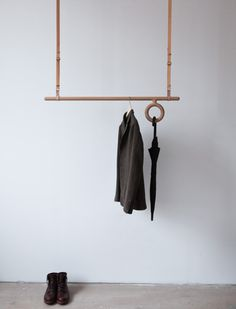 No closet, no problem: Pe, an adjustable wood and leather hanging coat rack by Florian Saulvia