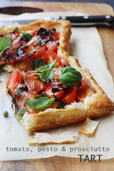 Baby Tomato, Pesto & Prosciutto Tart | from Scrummy Lane | A simple puff pastry tart topped with ricotta, baby tomatoes, pesto & prosciutto. Easy enough for a simple throw-together meal, but impressive enough to serve to guests.