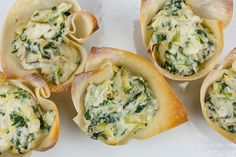 Fast and easy spinach artichoke cups are a tasty appetizer for any party. Sure to please all your guests! Finger food at it's best!