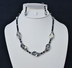 This glamorous necklace and earring set is designed with stunning smoky large 20mm Swarovski Black Diamond Cubist crystals with 7mm Bali antiqued Sterling bead caps on each side of these beauties. In