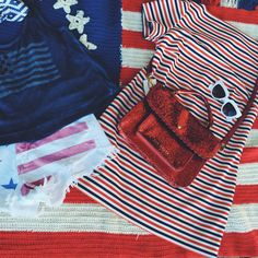 Fourth of July style: A red sparkly Ted Baker purse, New Merchandise sunnies, and all-American vintage dress. Printed flag shorts and a Jessica Simpson tank.