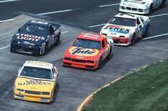 The Hendrick Racing Monte Carlos of Darrell Waltrip and Geoff Bodine dive under Mark Martin''s Roush Thunderbird race car, With Alan Kulwicki's Thunderbird in chase.