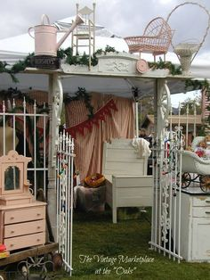 The Vintage Marketplace ~ love the gates and architectural pieces as an entrance to the booth!