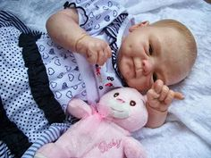 finally.....a baby doll with dimples....reminds me of my daughter...☺