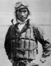 Yukio Seki (age 21) as a Lieutenant (Chui) of the Japanese Naval Air Force wearing life preserver. In 1944, he was killed in battle on Philippines open sea.