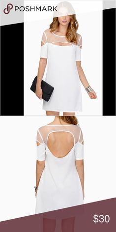 "TOBI white shift dress 100% Polyester Length: 32""/81.3cm Sleeve Length: 9.5""/24.1cm Side zipper closure    Note: Line dry  Measured on a  Model's profile: height 5' 6"", bust 32"", waist 23"", hips 33"" Tobi Dresses Mini"