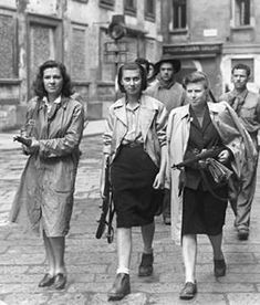 Italian Partisans Patrolling in Milan, 1945-As a result of all the new fascist policies, working women were left with even more hardships than they had faced prior to fascist rule. Even though the government provided welfare services and protective legislation for mothers, women were working for pay that was not enough to cover the simplest necessities. If they lost their job, they did not receive the unemployment benefits given to men for three months following the loss of a job…