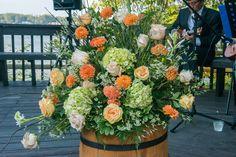 flowers in barrels