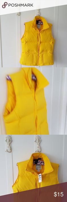 OLD NAVY Yellow  Down Vest Small NWT Old Navy lemon yellow Down vest Women's small   new with tags  inside pocket on left inside of vest TAGS: Shell lining 100% polyester fill down minimum 75% knew this product contains an amount of feathers not exceeding that allowable by law Close all fasteners before washing machine wash cold in front loading large capacity lower washer do not bleach must be rinsed and dried thoroughly tumble dry low do not iron do not dry clean Old Navy Jackets & Coats…