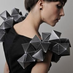 Amila Hrustic found inspiration in the ancient branch of mathematics and geometry. Platos Collection is made out of paper and textile and each dress corresponds to five Platonic solids.