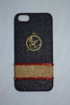 Glitter Hunger Games iPhone case from Etsy shop. Actually have this case and love it! Check out the shop!