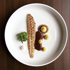 "Sole fillet, balsamic emulsion, butternut cream, mustard cress"""
