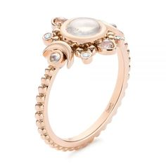 This breathtaking engagement ring features a round moonstone bezel set in the center, surrounded by a ring of moonstones and diamonds arranged in an. Diamond Bands, Gold Bands, Rose Gold Balayage, 4 Diamonds, Heart With Arrow, Diamond Engagement Rings, Engagement Jewelry, Moonstone Ring, Conflict Free Diamonds