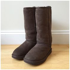 UGG | Classic Tall Brown Boots Authentic classic tall brown UGG boots. Only worn a few times and in excellent condition. No damage. Size 7. No PP, trades, or holds. Lowball offers ignored. Happy poshing!  UGG Shoes Winter & Rain Boots