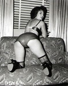 Pepper Powell snaps on rubber panties and poses for another of Irving Klaw's infamous Fetish photo sets..