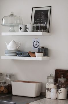 kitchen shelves in shades of white, grey and earth colours