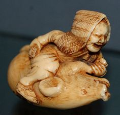 Wrestling with a Pig Netsuke Carved of Tagua Nut.