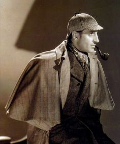 Basil Rathbone as Sherlock Holmes: silk scarf and multiple country fabrics fit for the world's greatest sleuth to investigate the mystery surrounding the Baskerville family