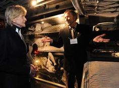 In the cramped quarters of the bunkroom display aboard the USS Joseph P. Kennedy, the museum's curator, Rich Angelini, tells former ambassador Jean Ann Kennedy Smith that her brother, Robert F. Kennedy, would've had a bunk just like those seen here.