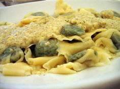 Pansotti -- A unique filled pasta from Recco, and other Ligurian towns.  Herbs combine in a top-secret recipe that's never quite right when you try it at home ... Often served with brown butter/sage  or salsa di noce.