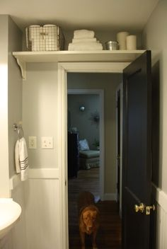 Over the door storage for a small bathroom. Great place to store bathroom related things you don't need that often.