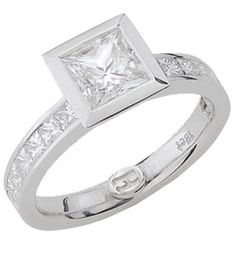 18ct White Gold Diamond Ring.      Hammer set princess cut diamond with channel set princess cut shoulder diamonds. Suits centre diamond from 0.40ct with shoulder diamonds from 0.04ct each.