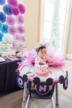 Birthday girl enjoying her smash cake from a Modern Rainbow Mickey Mouse Clubhouse Birthday Party via Kara's Party Ideas KarasPartyIdeas.com (4)