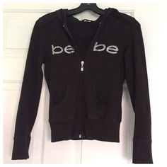 Bebe hoodie with rhinestone logo and lace trim Cute Bebe hoodie!  Preloved.  Satin lining inside good.  Mild fading on edges(see close-up picture).  Doesn't have string for hoodie(but does have holes for it with metal ring). bebe Tops Sweatshirts & Hoodies
