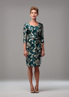 EMERALD AND GOLD JAQUARD DRESS  A scoop neck green and gold jaquard cocktail dress with three quarter length sleeves and a pencil skirt. Also available in teal and gold, and in a variety of dress, coat and jacket styles.