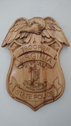 "Personalized Virginia State Trooper Police Badge V Carved Wooden Sign. This is a great gift for your Wife, Husband, Fellow Worker, Relative, Etc.. who is in law enforcement. We can make custom signs as well. Approx size is 11"" wide x 16"" high. Comes with Picture hanger on the back. These are made on our CNC machine and takes about 4 hours of machine time from start to finish."