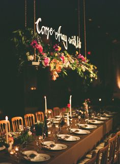 script above a lush flower box makes for an elegant, unique touch at the head table. Photo by Tec Petaja via 100 Layer CakeHanging script above a lush flower box makes for an elegant, unique touch at the head table. Photo by Tec Petaja via 100 Layer Cake Hanging Centerpiece, Floral Centerpieces, Wedding Centerpieces, Wedding Table, Wedding Reception, Bridal Table, Centrepiece Ideas, Wedding Dinner, Centrepieces