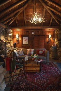 A comfy, cozy, and oh so charming, fireside cabin living area! (The antler chandelier, however, is definitely NOT for me!)