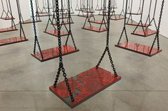 Mona Hatoum |  installation titled Suspended, a room full of swings initially evokes a playful atmosphere but, upon closer inspection, Hatoum has placed a randomly chosen map on each swing, representing the precariousness of war and randomness of its victims.