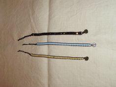 Pulseras de cuentas de cristal entre cordón de algodón y cierre de botón