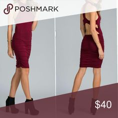 """BURGUNDY CUT OUT DRESS - SIZE LARGE..NEW NEW!! STRETCHY BODY CON CUT OUT DRESS -SIZE LARGE. THIS DRESS FEATURES A MIDI LENGTH SILHOUETTE,  A MOCK NECK AND RACER BACK WITH CUT OUTS, FINISHED WITH A RUCHING ON THE SIDES ON BOTTOM HALF. .. MATERIALS CONSIST OF 94% RAYON AND 6% SPANDEX. .. SHOULDER TO HEM - 40 """"  NEW NEW NEW IN PACKAGE! UNKNOWN Dresses Midi"""