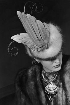 A feather and fur hat from 1939 that would surely draw every eye in the room to it.
