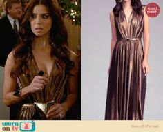 Carmen's gold plunge neck gown and star clutch on Devious Maids.  Outfit Details: http://wornontv.net/31526/ #DeviousMaids