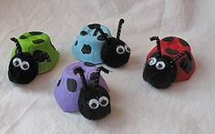 Recycled Ladybug Egg Carton Empty egg carton cup black pipe cleaners cut to approximately 2 inch pieces Small wiggle eyes (2 per ladybug) Medium black pom pom (1 per ladybug) acrylic paint ( variety of colors including black) Paintbrush White craft glue (or hot glue gun) Scissors