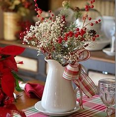 These charming and cozy farmhouse Christmas decor DIY ideas will add a rustic touch to your home this holiday season. Christmas Table Settings, Christmas Tablescapes, Christmas Table Decorations, Cheap Christmas Centerpieces, Homemade Decorations, Farmhouse Christmas Decor, Country Christmas, Diy Christmas Kitchen, Christmas Entryway