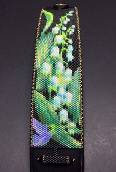 This is a Beautiful Beaded Peyote Lily of the Valley Bracelet. The dimensions for this bracelet are approximately 1.59in-inch width x 6.92in-inch length when using 11/0 Delica seed beads. There is a total of 20 bead colors, with a total bead count of 3000 beads (30 beads by 100 beads). This pattern does not include clasp instructions. And base knowledge of peyote beading is needed.  STITCH STYLE: Peyote WIDTH: 30 Beads (Approx 1.59in-inch) LENGTH: 100 Beads (Approx 6.92in-inch) NUMBER OF...