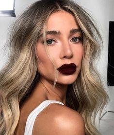 Deep burgundy lips.