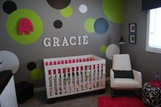 Modern Baby Room Ideas for Girls for Mom To Be: Grey Wall White Single Sofa Red Rug Floral Round Sofa White Cabinets Colorful Modern Baby Ro.
