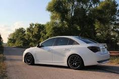 Image result for black chevy cruze with white wheels