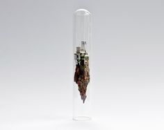 For her series Micro Matter, Amsterdam-based designer and art director Rosa de Jong created towering houses and tall buildings inside the narrow confines of large glass test tubes. Perhaps comparable to a ship in bottle, the little houses and buildings are all handmade using natural objects and some