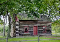 American Salt Box-style log cabin, with second story for children to sleep. Split-shake roof. Squared-off logs with daubing or chinking between logs, to fill air gaps. Stone chimney. #LDS #cabin