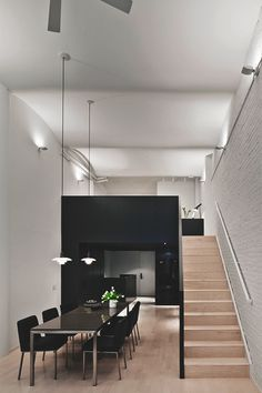Living Pursuit : Photo Wooden stairs with black wall.
