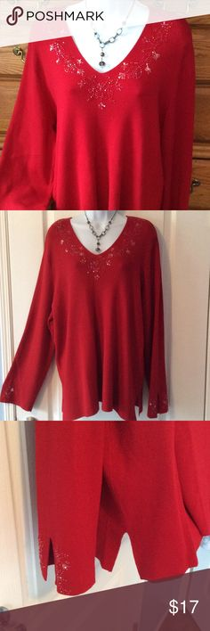 "Lane Bryant Red Sweater 70% rayon and 30% nylon.  Very good condition.  True red...a blue red not an orange red.  Has side slits and also has slits at the end of the arms as I tried to show in the third picture.  Approximately. 28"" in length and when laid flat and measured from armpit to armpit it is 21"" across. Has stretch.  Embellished at the neck line and at the end of the sleeves.  Size says 18/20 Lane Bryant Sweaters V-Necks"