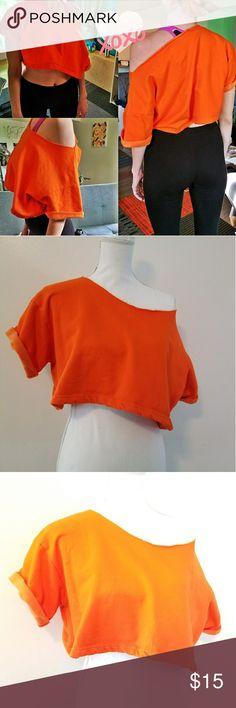 "Cropped Sweatshirt Super cute off shoulder, oversized cropped sweatshirt  Orange in color  Approximate measurements  PTP 24"" LENGTH 15"" Basix of America Tops Crop Tops"